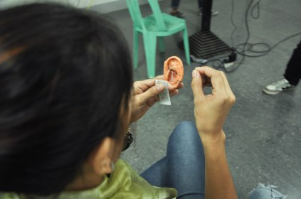 Trainee studying the point locations on the ear model.